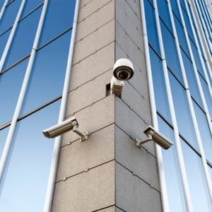 3 Security Cameras on Side of Building